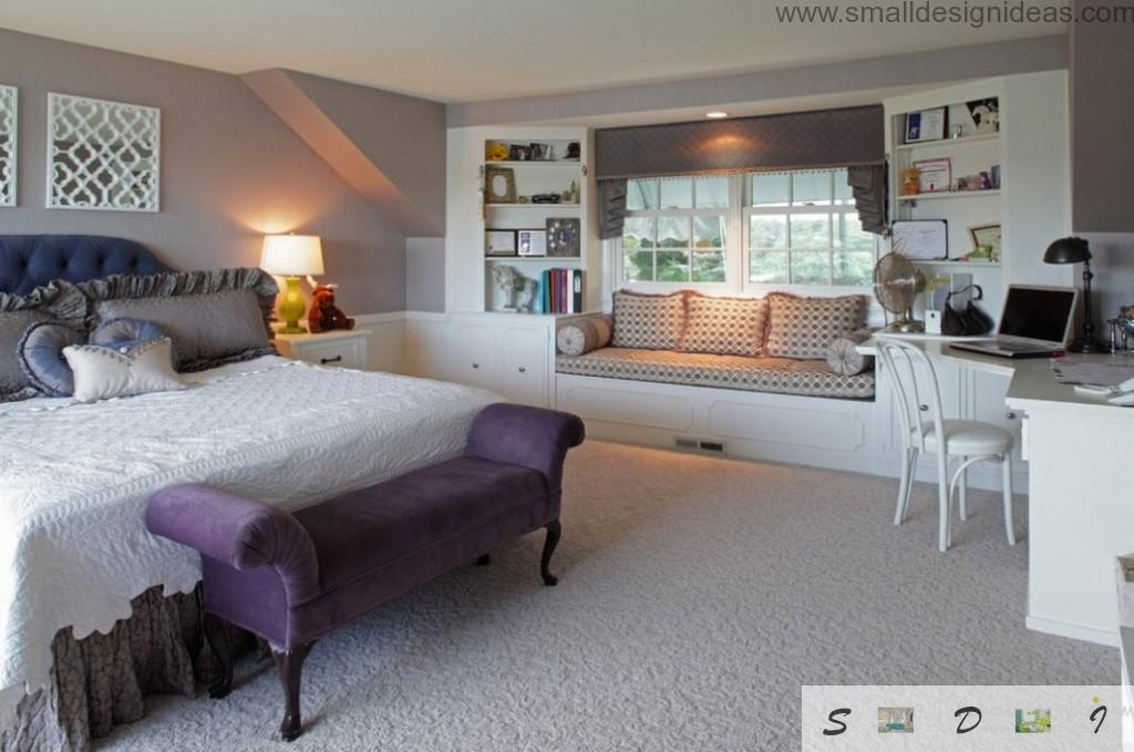 soft bedside table and a lot of purple cushoind in the bedroom design interior