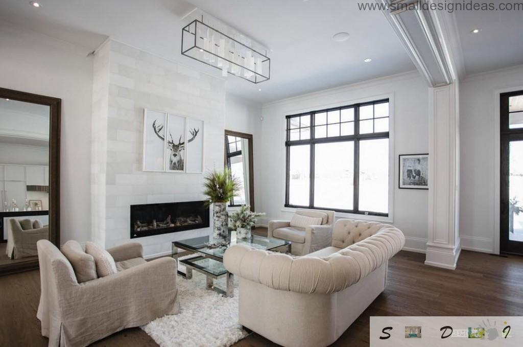 White interior of the rest room with deer picture and decorative fireplace along with IKEA upholstered furniture looks harmoniously