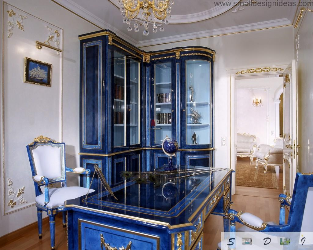 Royal study room for serious respectable man in the house with blue furniture and stucco wall decoration