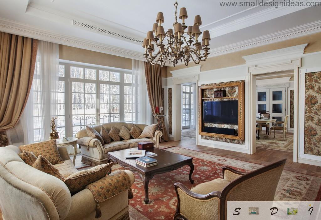 Big metal beige chandelier and a fake hearth as a decorative elements in the classic living room