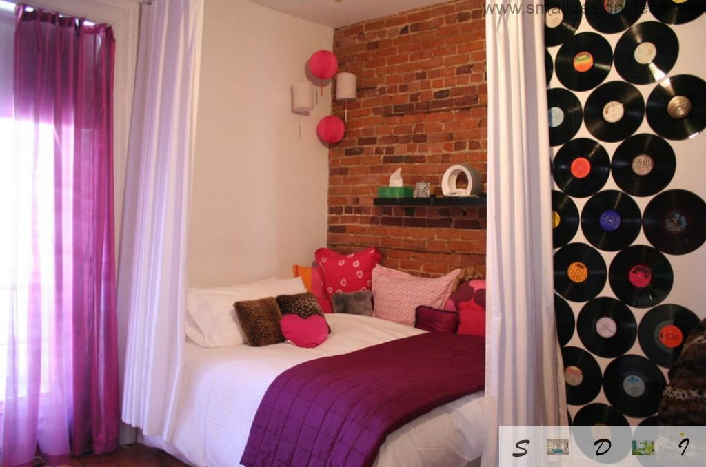 brickwork and purple colors in the bedroom for little girl