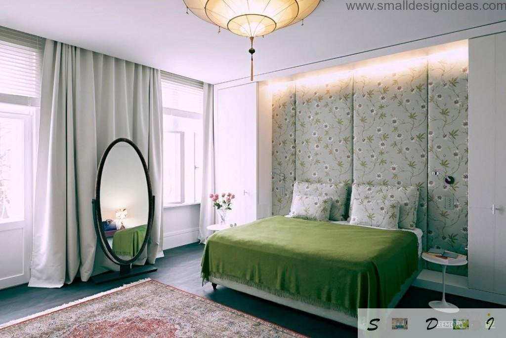 Wall decoration by wallpaper. Mirror and green cover in the bedroom