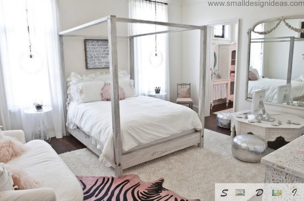White bedroom in the girl`s bedroom with wooden skeleton and pink elements