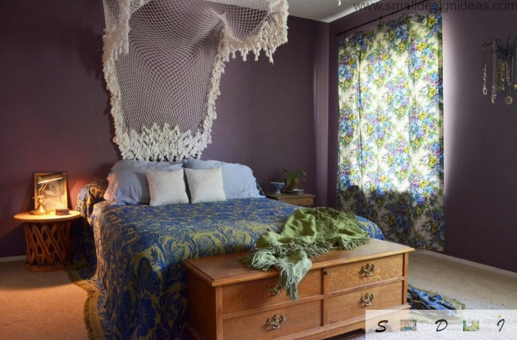Rustic notes in the purple interior of the bedroom with the net and covered windows to make shades