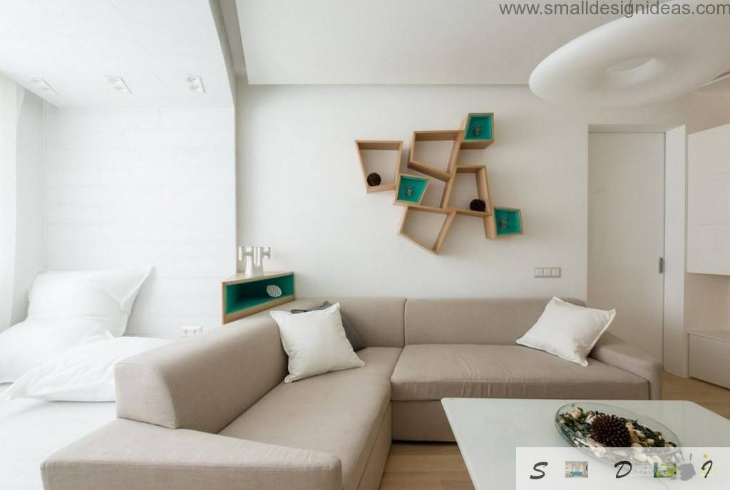 Unique racks at the wall and the white interior with angle sofa from IKEA