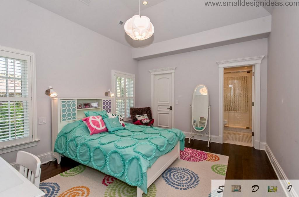 Turquoise bed cover in the joyful teen girl bedroom