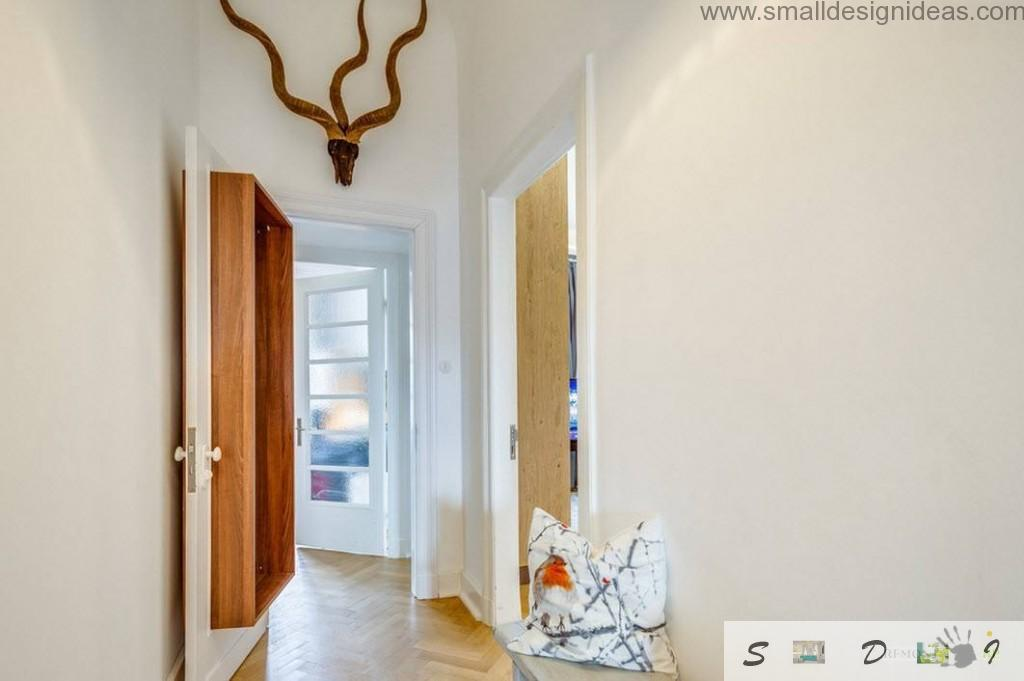 Loft German Apartment Interior Decorating Ideas. Hall entrance and stylization imitating antlers of spiral-horn goat