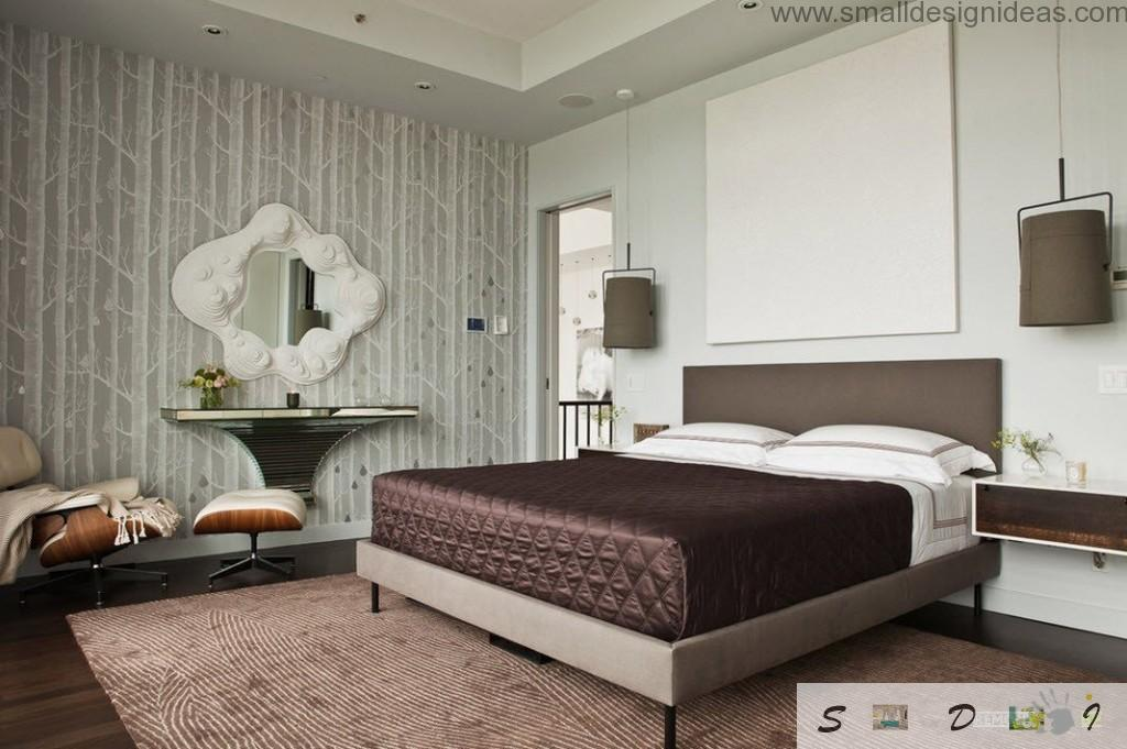 Black coffee mattress as decorative element in the light green wallpapered bedroom