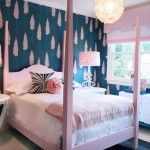 Pink bed frame, linen and pink dots on wallpaper in the bedroom