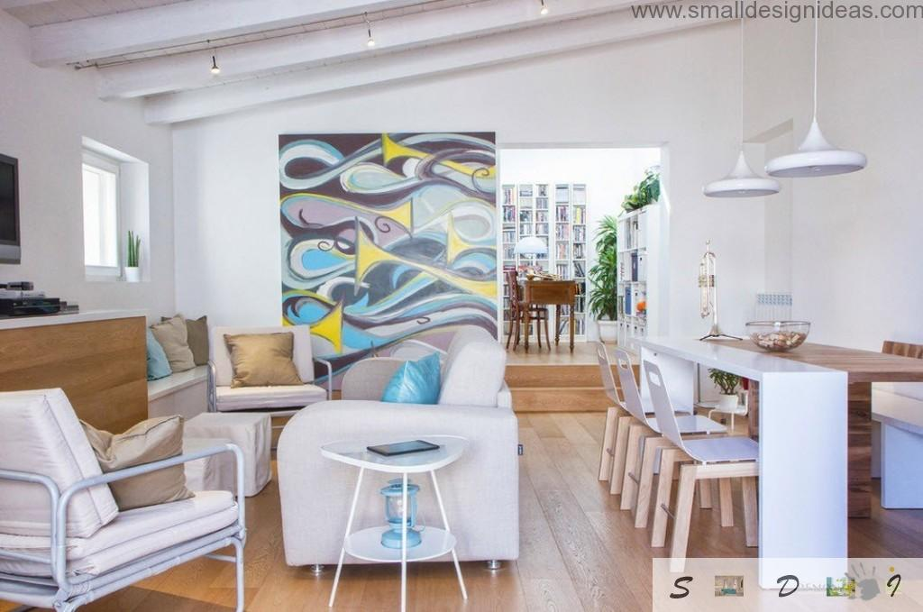 Paintings in the bright and spacious living room interior with IKEA furniture