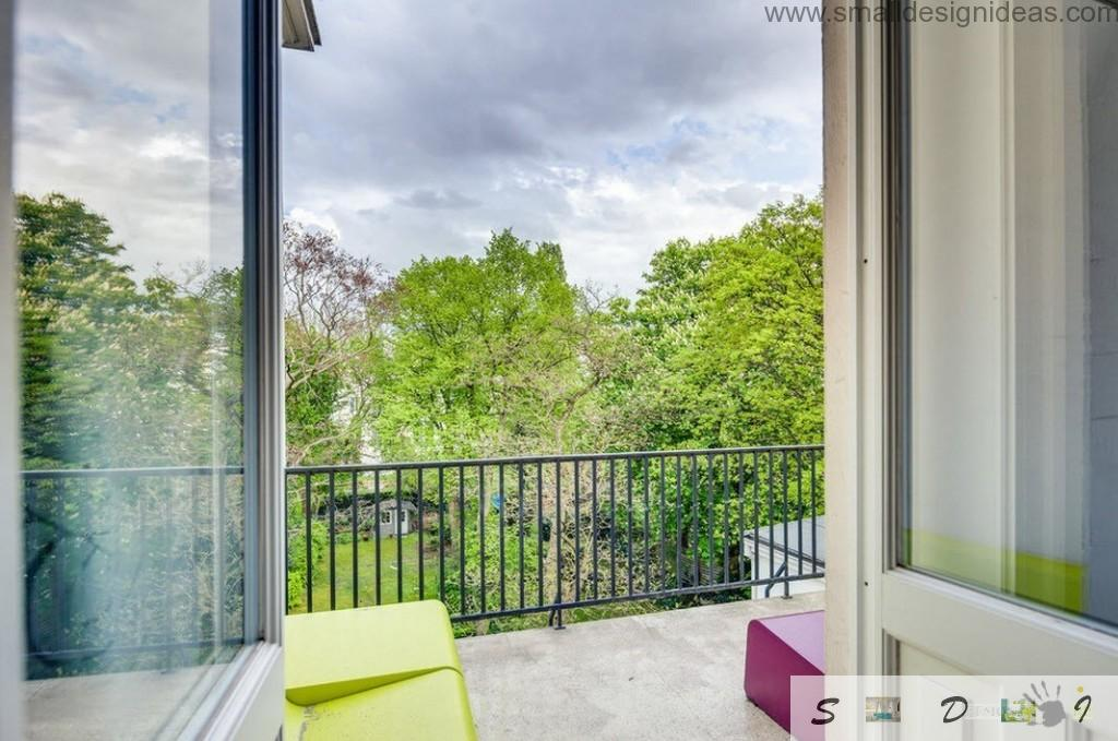 Nice view from the window to the balcony and nature in the cool modern German loft apartment
