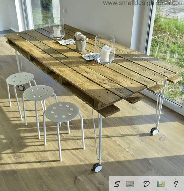 Original style of the handmade pallet table in castors and in the modern austere interior