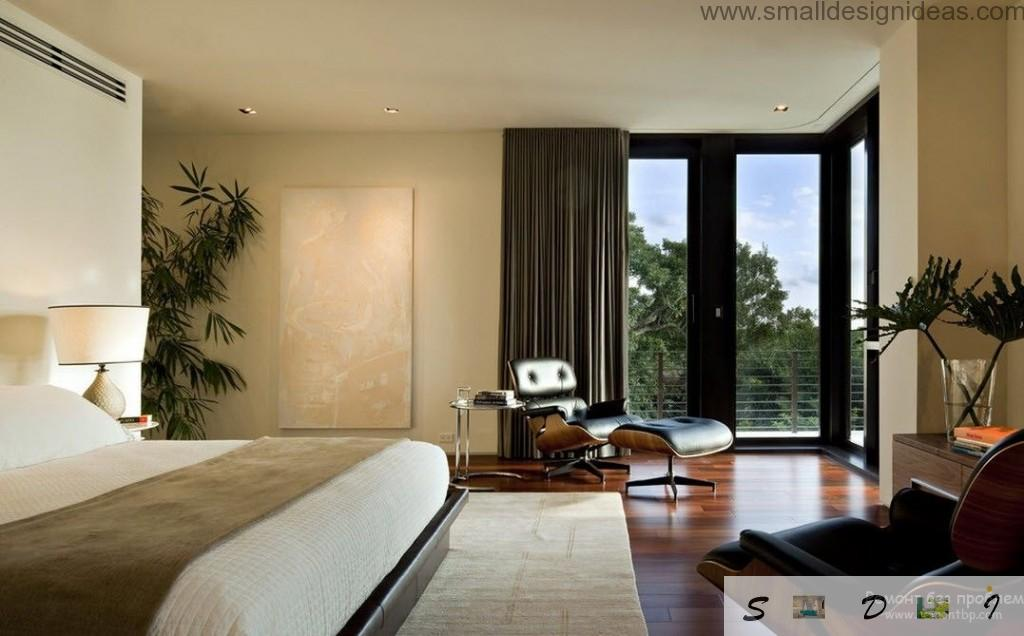 Men`s bedroom in the countryside house in dark and pasel tones with big window and dark curtains