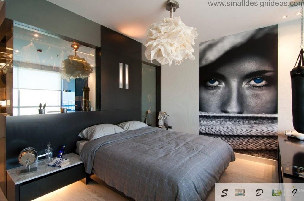 Unusual men`s room design with huge poster, mirror at the wall and tule lamp