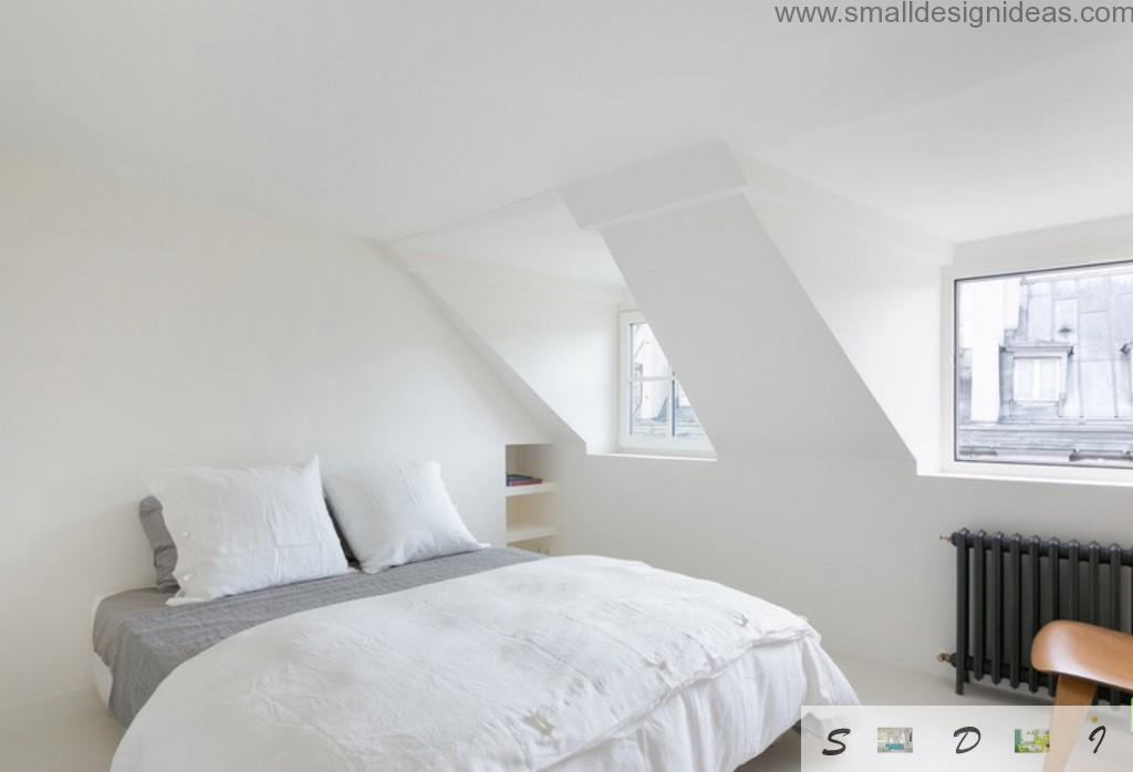 Vaulted ceiling and IKEA royal sized bed with white pillows