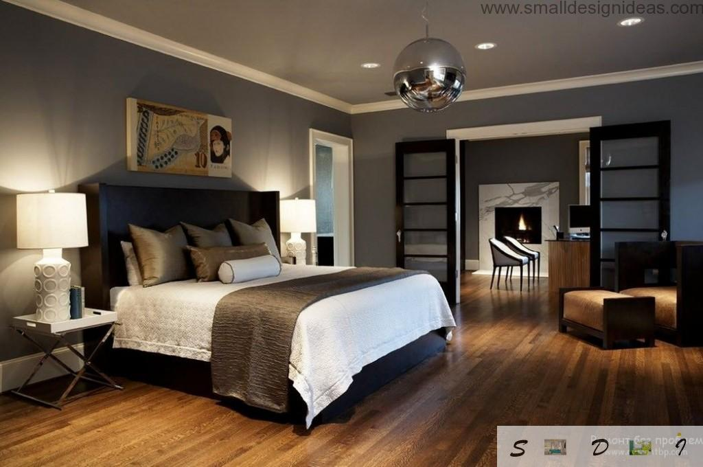 Wide bed in spacious royal dark modern bedroom