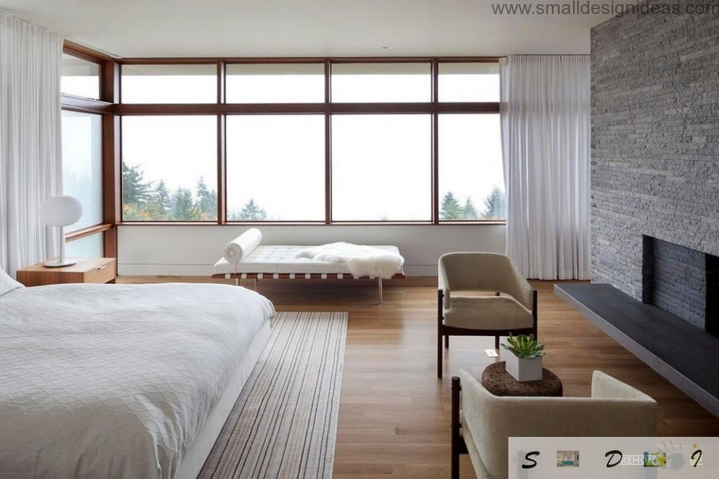 White folded sofa at the wide windiw and the kingsize IKEA bed of the spacious Asian apartment