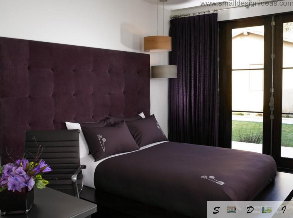 Dark bedroom with purple color accents looks royal and chic