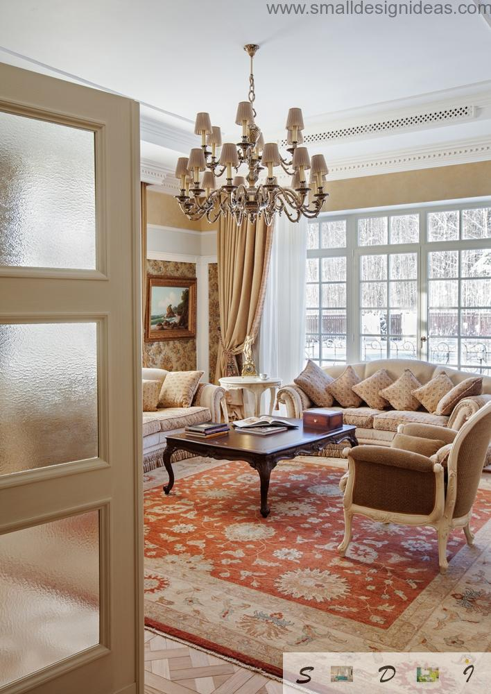 Glance from out the door into the classic interior of the house`s living room with big day sofa with cushoins