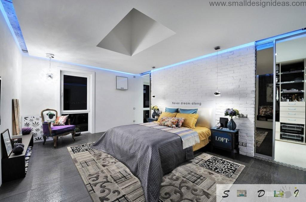 Futuristic hi-tech interior design in the dark and light bedroom with masonry wall at the headboard
