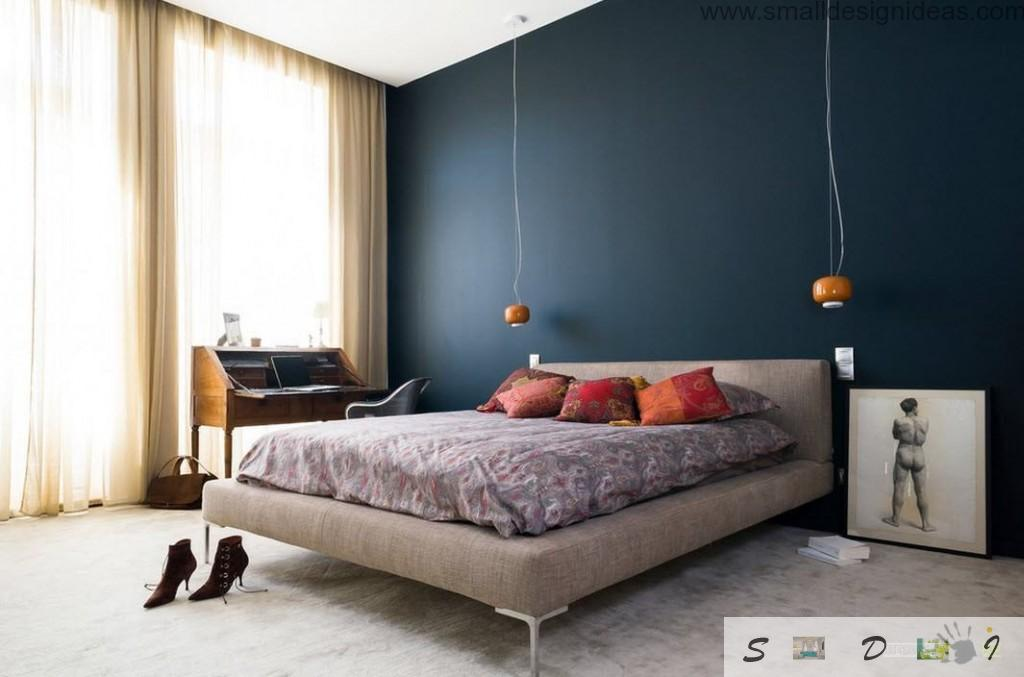 Darl acceте wall in the modern bedroom and a lot of decorative elements