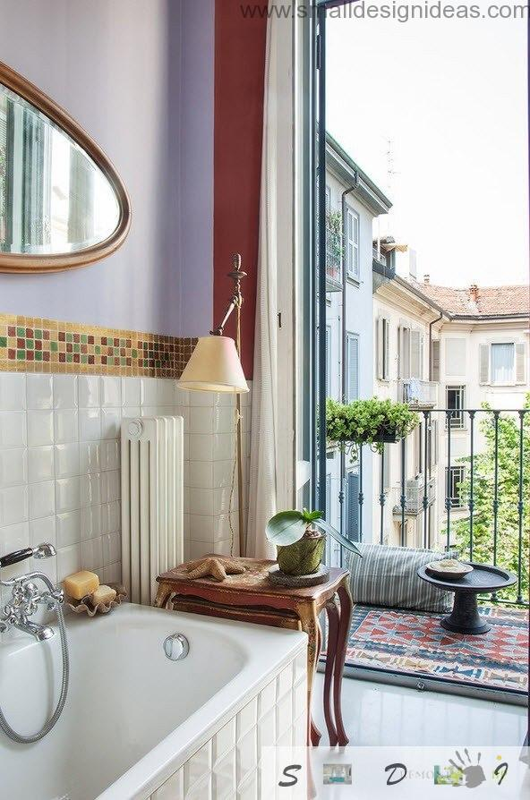 Bathroom with opened wide windows and mix of tiles and wall paint in contrast to another decorative elements in Milan