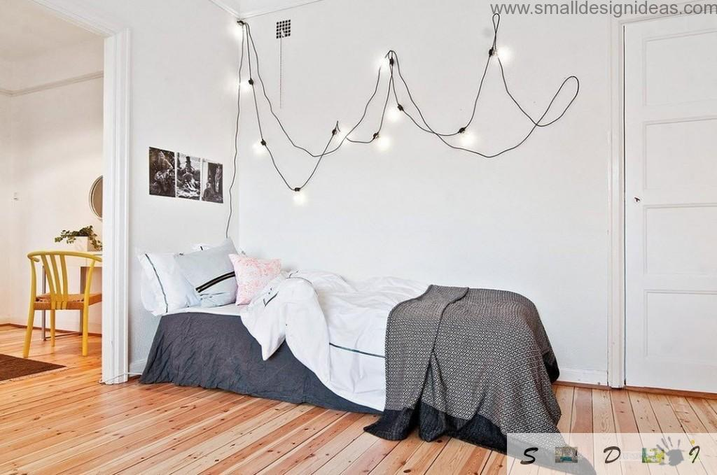 Wired garland wall decoration in the white bedroom