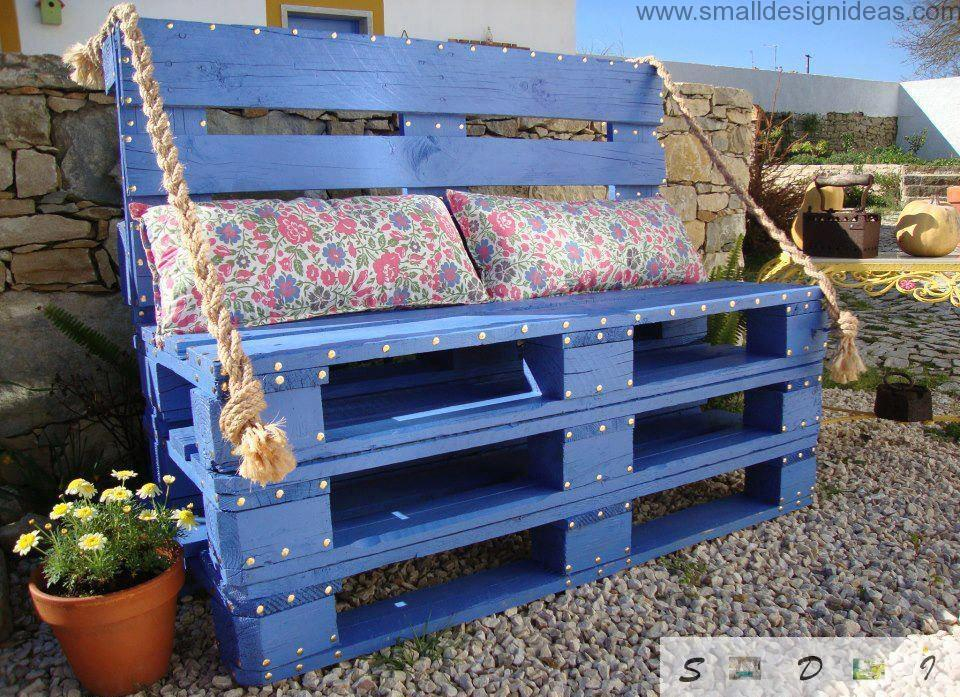 Blue outdoor sofa of indutrial pallets with soft colored cushions