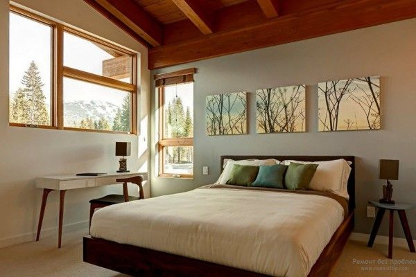Windows and wall pictures as the transition of nature into the original men`s bedroom