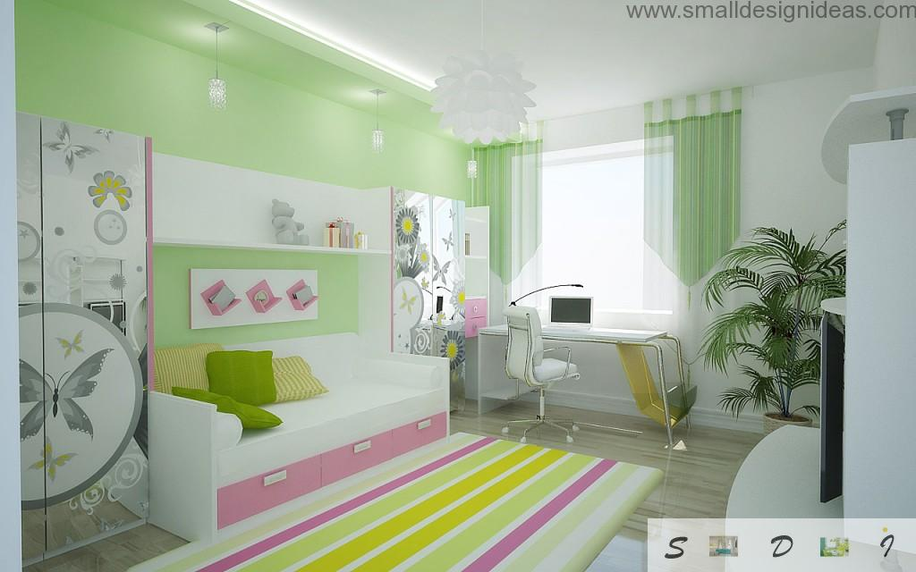 Decorated baby room with original trimming and carpet, bed with drawers and working place