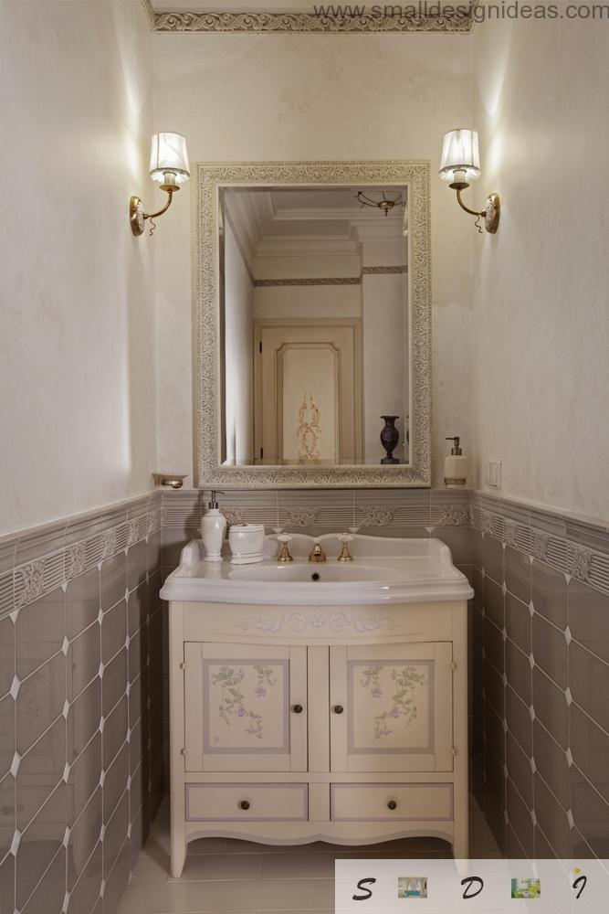The mirror and the schest of drawers for hygiene procedures in the classic interior of bathroom