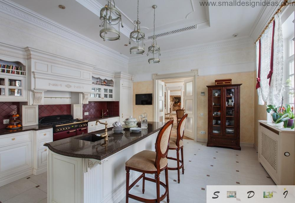 Island kitchen with ceramictile and white color gamma in the classic style of private house