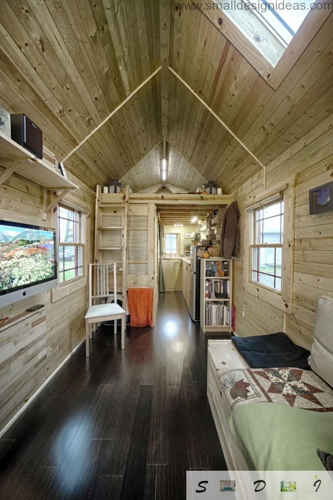 prospective on the ladder and upper tier with bed in the mobile wooden house