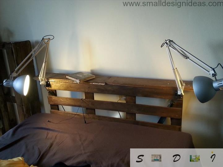 Classy pallet bed with swivel lamps and brown stylistic