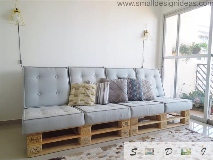 Pallet base of the handmade sofa with soft pads and cushions