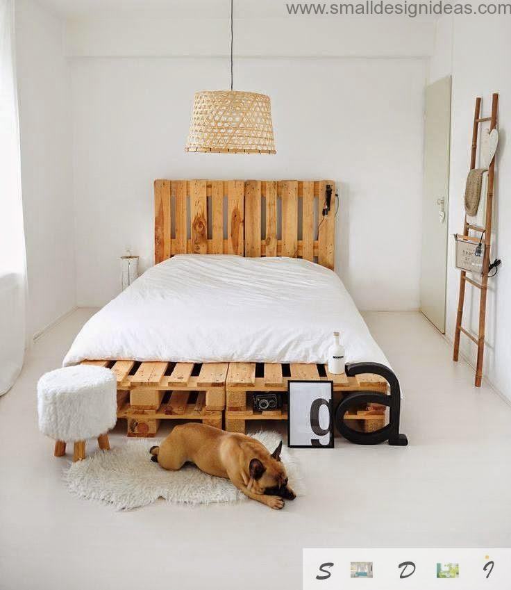 Fresh wooden and white bedroom with pallet king size bed and bedside poof