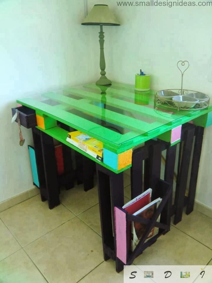 Unique green and black pallet DIY table under the glass countertop and side boxes for storage