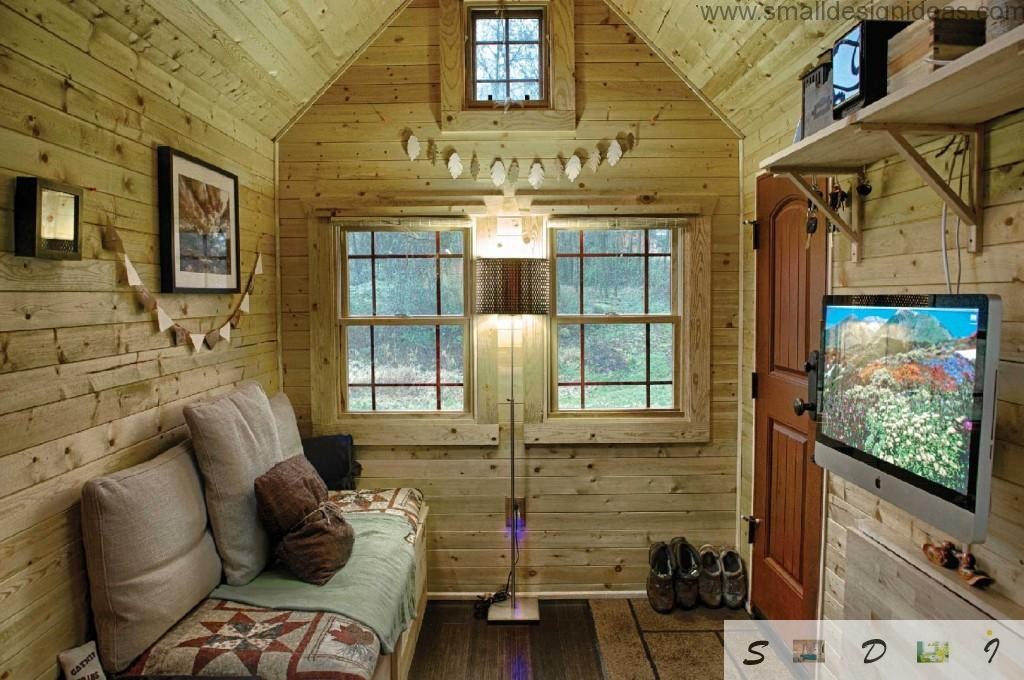 Interior of the wooden mobile house. Living room and the hall in one