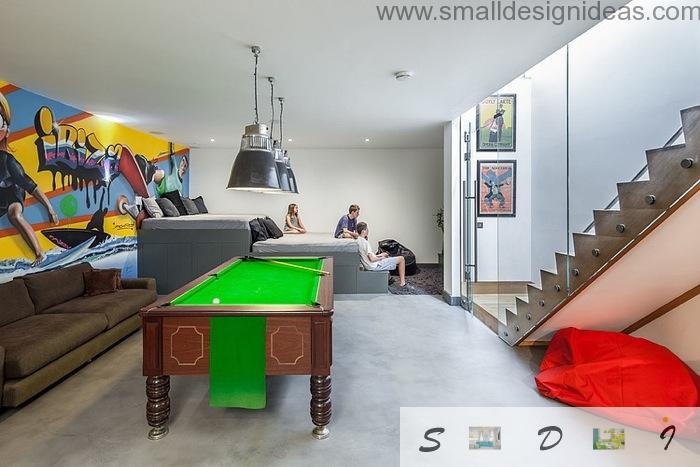 Green billiard table and the contrasting red element with yellow decorated wall in the living room playground