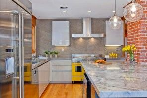 Perky yellow elements in bright decor of the hi-tech kitchen