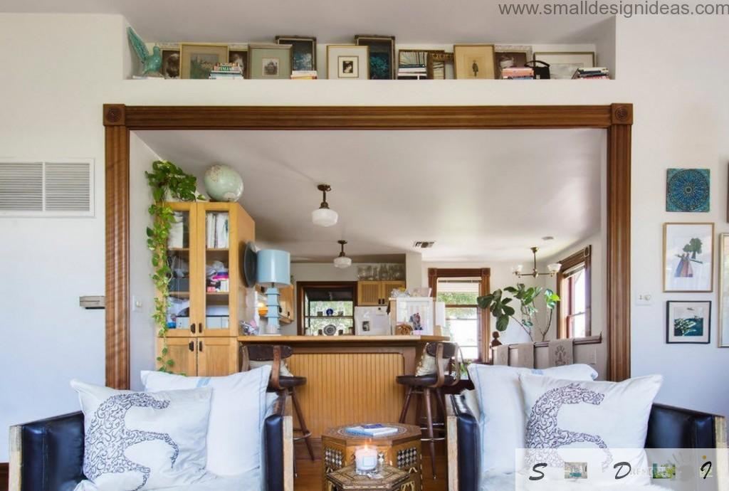 Perspective view to the eclectic kitchen next to the living in the private cottage