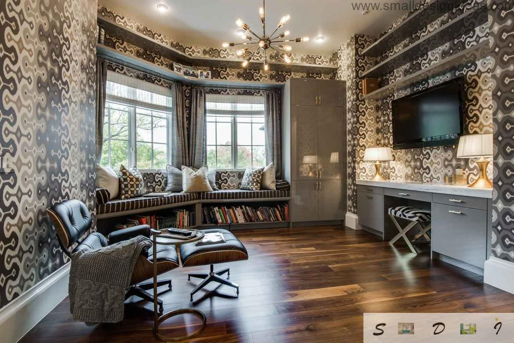 Gray and creamy living room with original leather furniture and soft pillows on the windows