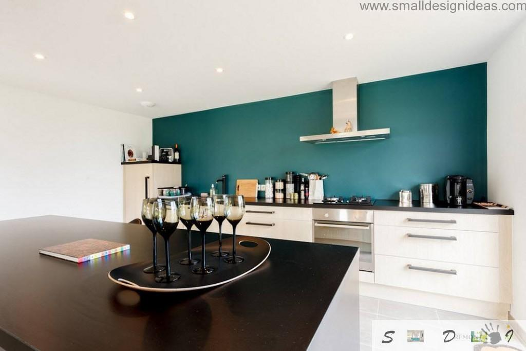 Modern private house has a kitchen zone within the large living