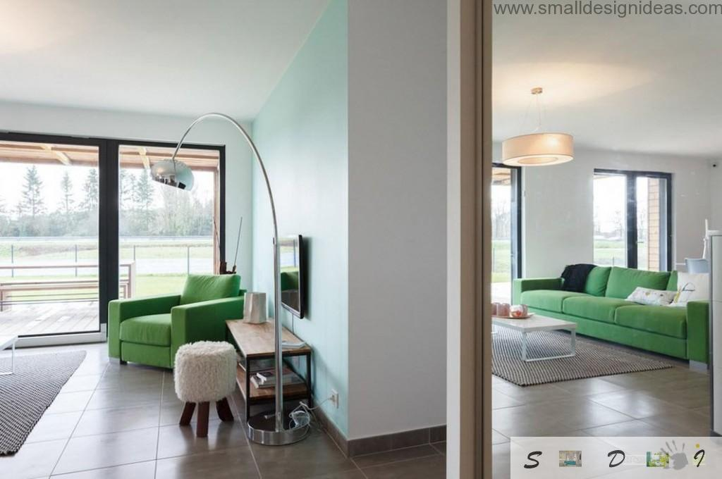 Mirror reflection of the fresh modern living room in the uncommon designed modern house