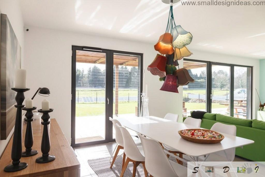 Garland of the lamps and sweets in the spacious living/dining room of the modern house