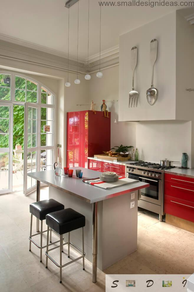 Original modern kitchen design with red blotches of furniture in the country house