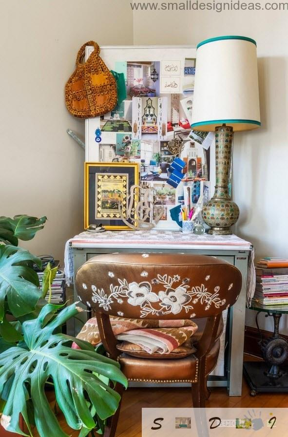 painted chair and the lots of stuff at the table in the living room of eclectic private house