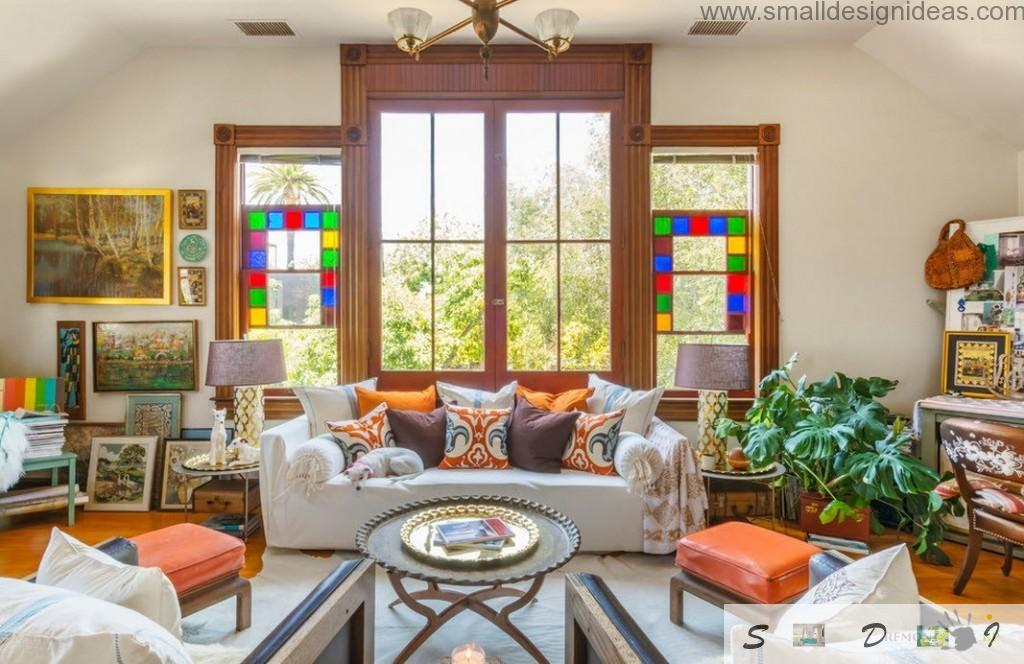Mosaic windows in form of kaleidoscope in eclectic interior of the private house