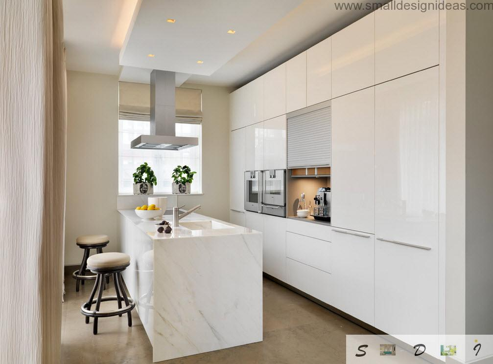 Marble island in the center of the bright white themed kitchen