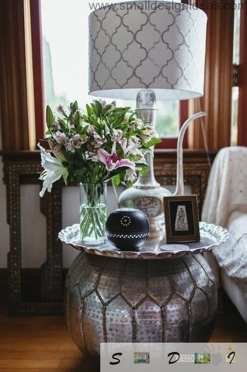 Vase-like coffe table in the living room is used as a stand for flowers and personal things of the households